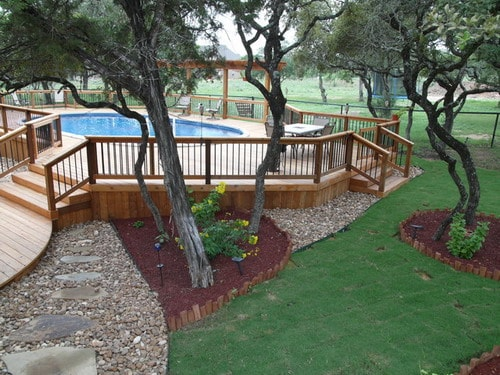 Oval-above-ground-pool-with-deck-traditional-pool-backyard-garden-landscape-ideas