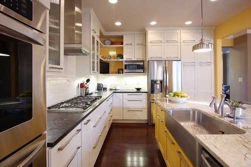 Long-Narrow-Peninsula-Style-Transitional-Kitchen-by-NVS-Remodeling-Design