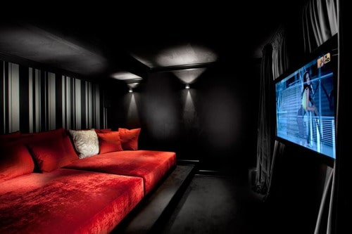 Red-sofa-black-wall-paint-colors-contemporary-home-theater-media-room-designs