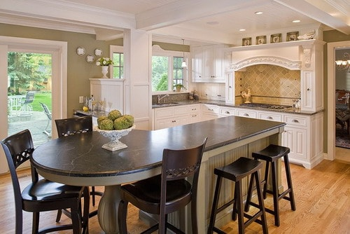 Wooden-bar-stool-curved-island-traditional-kitchen-white-cabinets