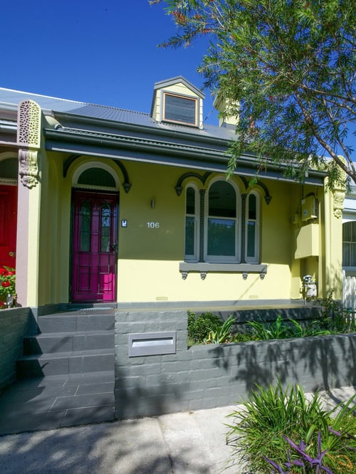 Small victorian green two-story brick exterior in Sydney with a flat roof