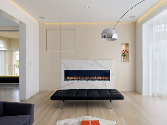 modern-living-room-idea-in-san-francisco-with-beige-walls-and-a-ribbon-fireplace